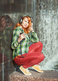 Hipster girl with headphones listening music Royalty Free Stock Image