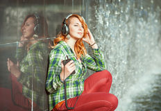 Hipster girl with headphones listening music Royalty Free Stock Images