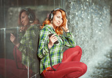 Hipster girl with headphones listening music Stock Photo