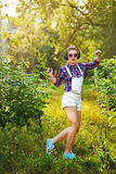 Hipster girl with headphones and the player is dancing in the pa Royalty Free Stock Images
