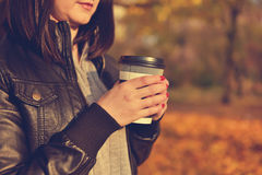 Hipster girl holding coffee cup Stock Photography