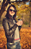 Hipster girl holding cup of coffee Stock Photo
