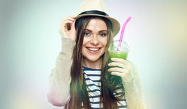 Hipster girl holding glass with green juice. royalty free stock photo
