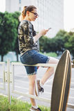 Hipster girl installs mobile applications Royalty Free Stock Photo