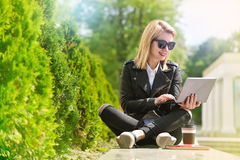 Hipster girl with laptop Stock Photography
