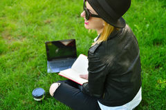 Hipster girl with laptop Stock Photos