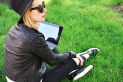 Hipster girl with laptop. Hipster girl sitting with laptop in hand, view from above stock image