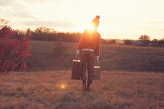 Hipster girl leaving. Hipster styled leaving woman outdoors royalty free stock images