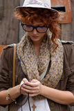 Hipster girl listening to music on mp3 player Royalty Free Stock Photography