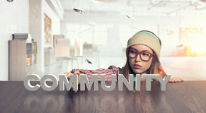 Hipster girl looking from under table Stock Photography