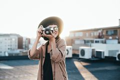 Hipster girl makes photos on analog camera royalty free stock images