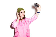 Hipster girl makes self-portrait Royalty Free Stock Image