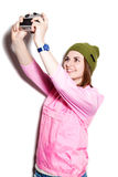 Hipster girl making self-portrait Royalty Free Stock Images