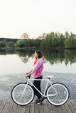 Hipster girl with modern bike Royalty Free Stock Image
