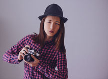 Hipster girl with old photo camera Stock Photo