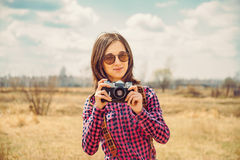 Hipster girl with old photo camera Royalty Free Stock Images