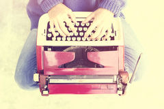 Hipster girl with old style typewriter. Mock up Stock Photo