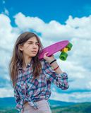 Hipster girl with penny board. skateboard sport hobby. Summer activity. plastic mini cruiser board. Spring. Urban scene. City life. ready to ride on the street stock photos