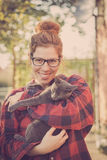 Hipster girl playing with her cat Stock Image