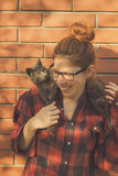 Hipster girl playing with her cat Royalty Free Stock Photography