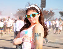 Hipster girl pointing to rad tattoo after marathon race Stock Photos