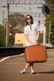 Hipster girl at railways platform. Stock Photos
