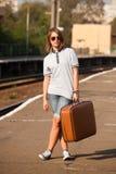 Hipster girl at railways platform. Stock Images