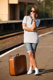 Hipster girl at railways platform. Stock Photo