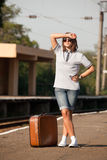 Hipster girl at railways platform. Stock Image