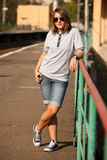 Hipster girl at railways platform. Stock Images