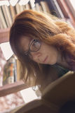 Hipster girl reading a book Stock Image