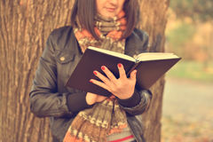 Hipster girl reading a diary Stock Photos