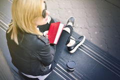 Hipster girl with a red book Royalty Free Stock Photos