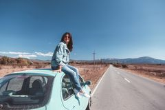 Girl enjoying road trip Royalty Free Stock Photo