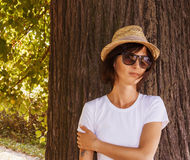 Hipster girl relaxing in the park Stock Image