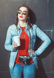 Hipster girl with retro camera and cup of coffee Royalty Free Stock Image
