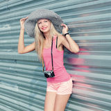 Hipster girl with retro camera Royalty Free Stock Image