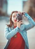 Hipster girl with retro camera Stock Photos