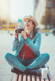 Hipster girl with retro camera Royalty Free Stock Photography