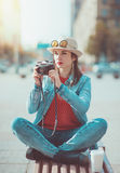 Hipster girl with retro camera Royalty Free Stock Images