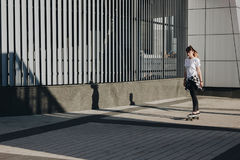 Hipster girl riding skate board Royalty Free Stock Photography
