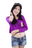 Hipster girl showing thumb up in studio Stock Images