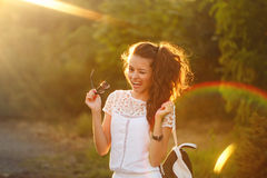 Hipster girl showing tongue and winks. Royalty Free Stock Image