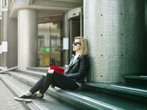 Hipster girl sitting on stairs Royalty Free Stock Image