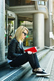 Hipster girl sitting on stairs Royalty Free Stock Photos