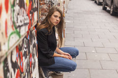 Hipster girl sitting on the street. Walk. Royalty Free Stock Photo