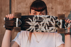 Hipster girl with skate board Stock Photo