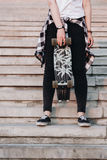 Hipster girl with skate board Royalty Free Stock Photography