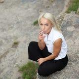 Hipster girl smokes. Stock Photo