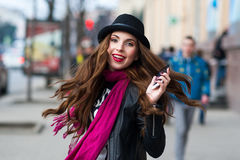Hipster girl speaks by phone and smiles Royalty Free Stock Photos